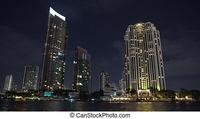 business center of a modern city, a metropolis at night. life is boiling. light from office windows in skyscrapers