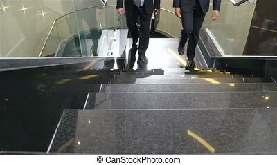 Business Centre Routine - Shoes of two male businessmen...