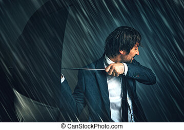 Business challenge and difficulties concept with businessman in rain