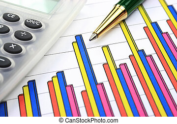 Business chart, calculator and pen