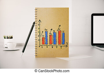 Business chart in spiral notepad