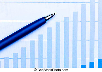 Business charts and pen