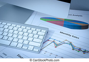 business charts or graphs with keyboard vignetted