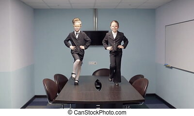 Little business childrens stepping on the table. defile