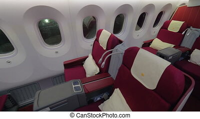 Business class - jet airplane interior view - Wide shot of a...