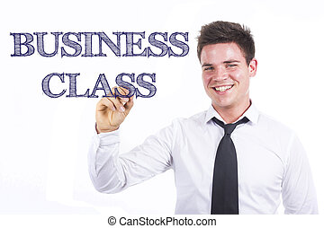 BUSINESS CLASS - Young smiling businessman writing on transparent surface