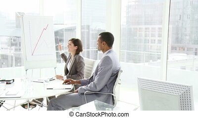 Business co-workers interacting in - Business people in a...