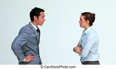 Business co-workers quarreling against white background