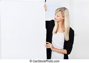 Business coach giving in house training - Attractive female...