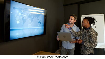 Business colleague discussing over digital screen 4k