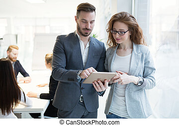 Business colleagues at their workplace in office