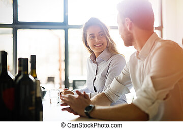 Business colleagues dating in restaurant