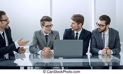business colleagues discussing business plan at the meeting