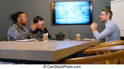 Business colleagues discussing in the conference room at office 4k
