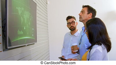 Business colleagues discussing over lcd screen 4k - Business...