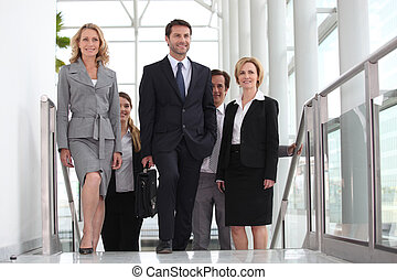 Business colleagues going to meeting