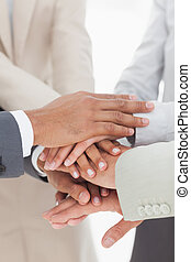Business colleagues hands together