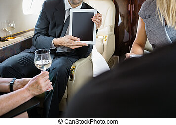 Business Colleagues Meeting In Private Jet