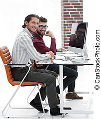 business colleagues sitting at a Desk.