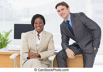 Business colleagues sitting in office