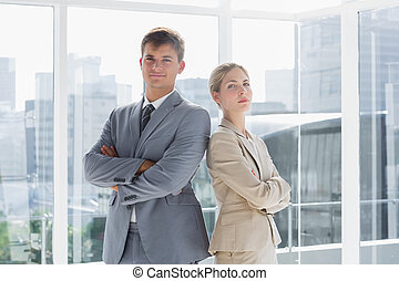 Business colleagues standing in their office
