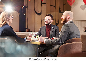 Business colleagues talking in cafe