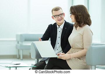 business colleagues use looking at the laptop screen