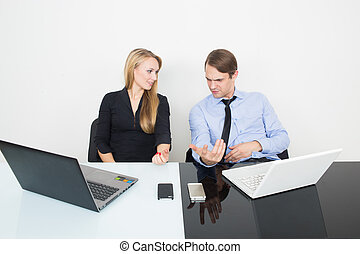 business colleagues with laptop and digital tablet in meeting at office desk. show that the arms