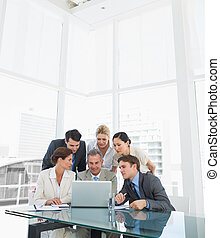 Business colleagues with laptop at