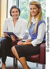 Business colleagues with tablet
