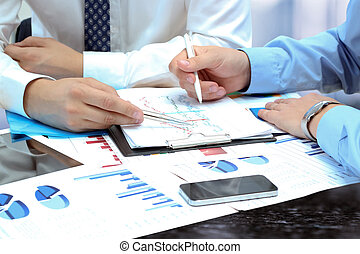business colleagues working together and analyzing financial...