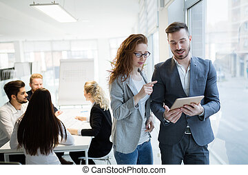 Business colleagues working together at office