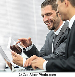 business colleagues working with tablet computer.