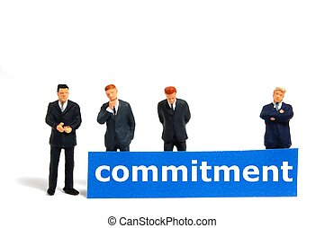 business commitment with small toy man isolated on white...