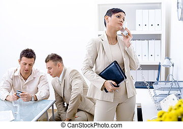 Business Communication - Businessteam of three working at...