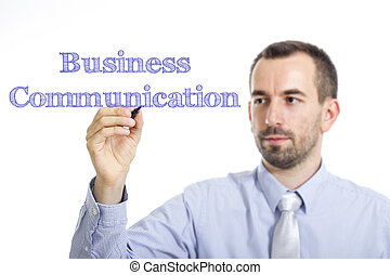 Business Communication - Young businessman writing blue text on transparent surface
