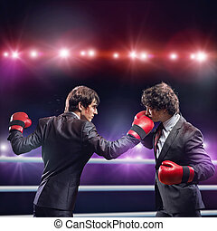 Business competition - Two businessman with boxing gloves in...