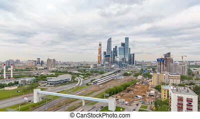 Business complex of skyscrapers Moscow city timelapse. In the foreground the railway and automobile overpass.