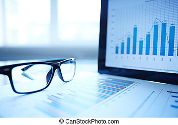 Business composition - Image of paper, eyeglasses and...