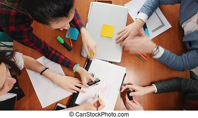 Business concept. A productive working team having a...