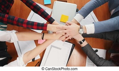 Business concept. A united working team put their hands together