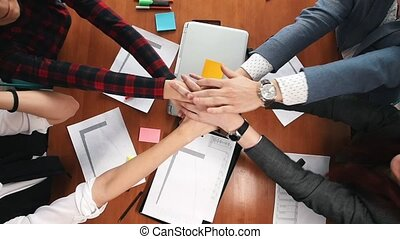 Business concept. A working team put their hands together