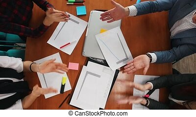 Business concept. A young working team clapping their hands