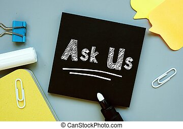 Business concept about Ask Us with sign on the piece of paper.