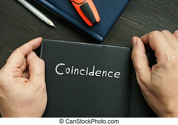 Business concept about Coincidence with phrase on the piece of paper.