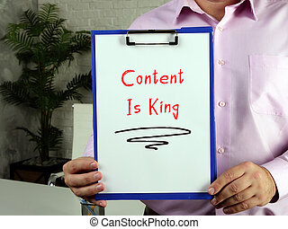 Business concept about Content Is King with phrase on the page.