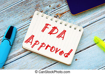 Business concept about FDA Approved with sign on the sheet.