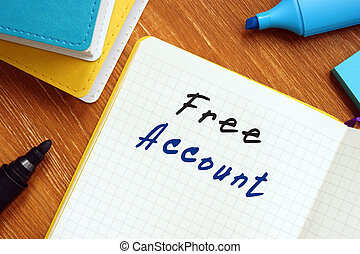 Business concept about Free Account with inscription on the sheet.