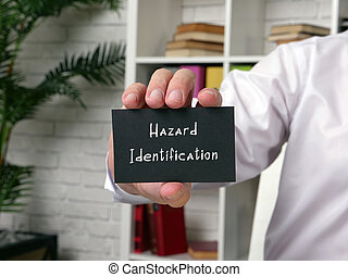 Business concept about Hazard Identification with sign on the piece of paper.
