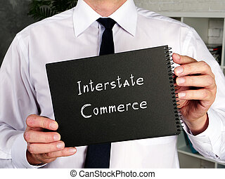 Business concept about Interstate Commerce with sign on the page.
